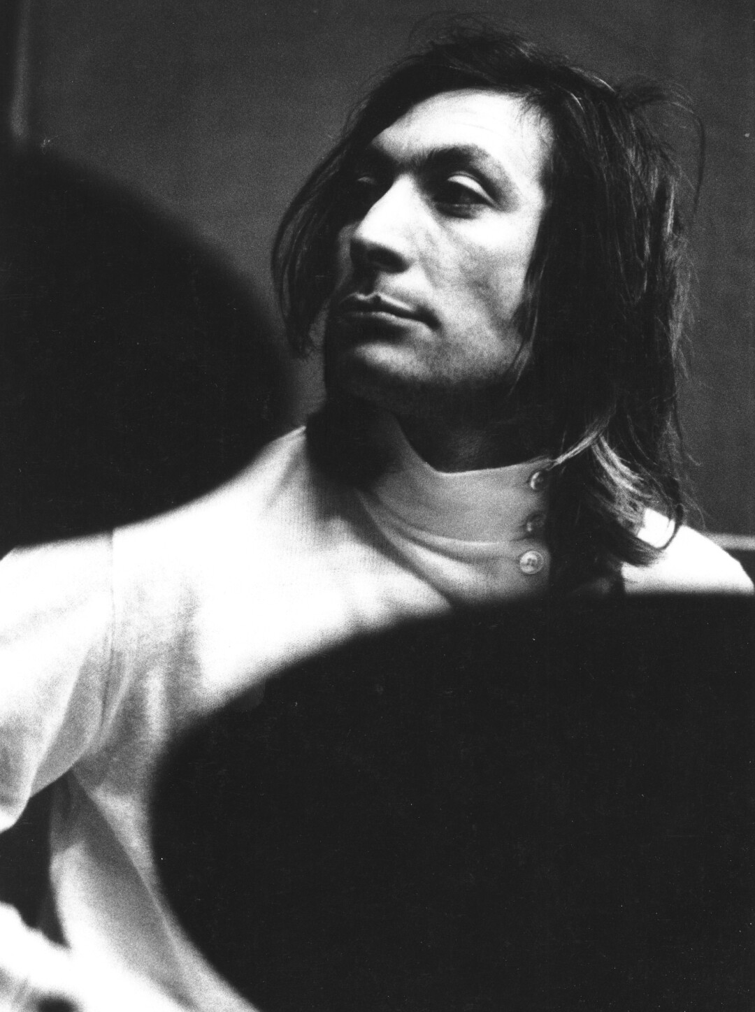 A black-and-white portrait, circa 1968, of Rolling Stones drummer Charlie Watts.