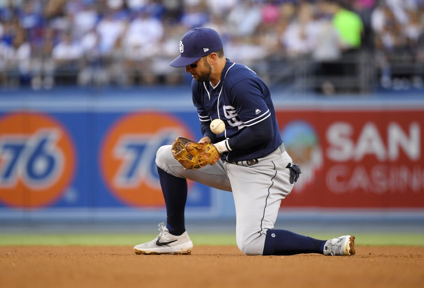 San Diego Padres second baseman Greg Garcia bobbles a ball hit by Los Angeles Dodgers' Matt Beaty during the fifth inning of a baseball game Saturday, Aug. 3, 2019, in Los Angeles. Beaty was safe at first on a fielder's choice to second on the play and one run scored. (AP Photo/Mark J. Terrill)