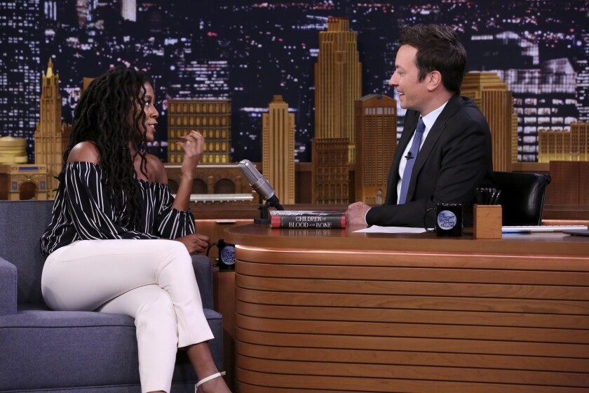 "Tomi Adeyemi sits across from Jimmy Fallon as a guest on ""The Tonight Show"" in 2018."