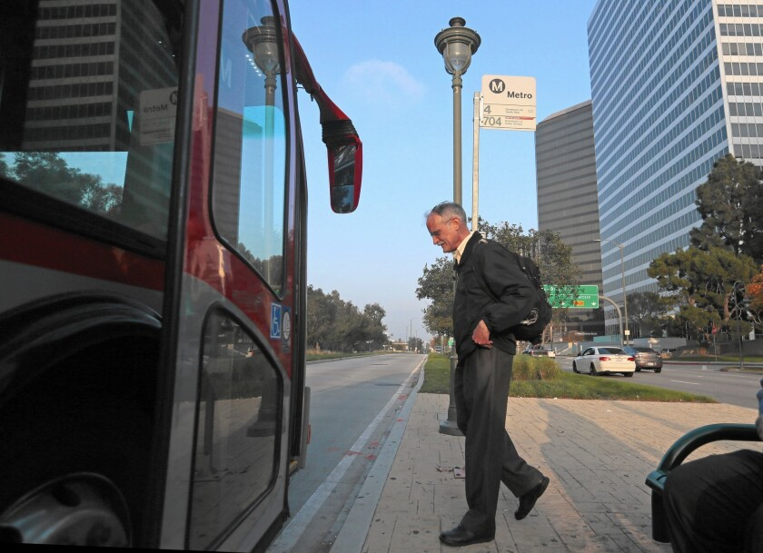 """Tom Fleming, who participates in the """"parking cash-out"""" program, boards a bus in Century City. He loves getting $215 a month and ending up paying only $8 for his transit pass."""