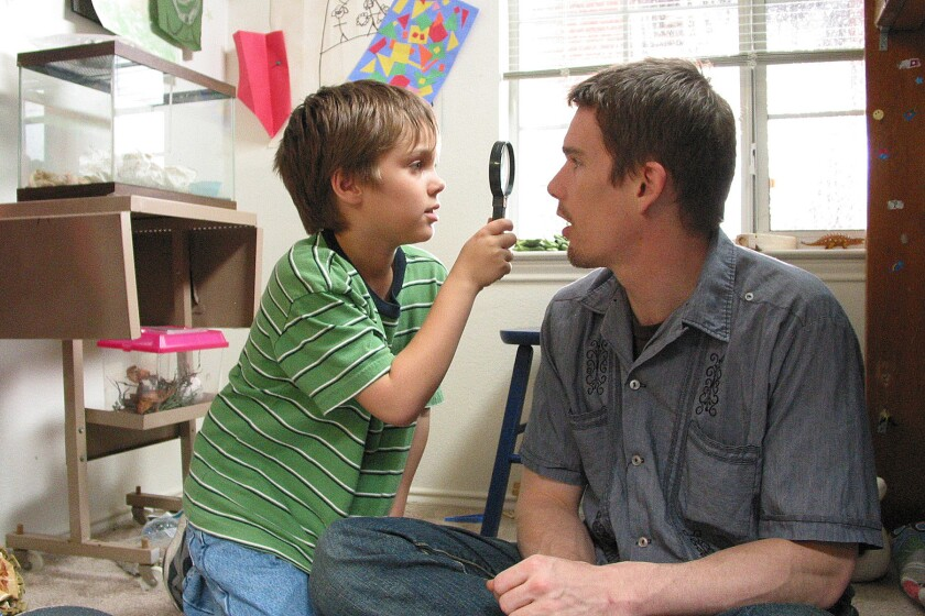 "Ellar Coltrane and Ethan Hawke in a scene from ""Boyhood."""