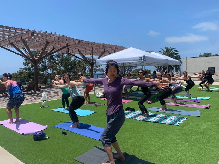 VibeFlow Yoga hosted a free yoga class at the Del Mar Farmers Market.