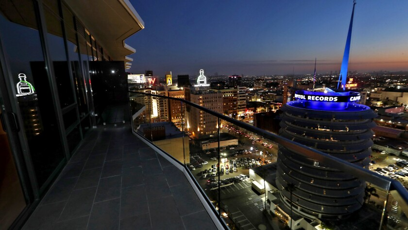 A balcony view at night from a penthouse suite at Argyle House, an 18-story luxury apartment tower i