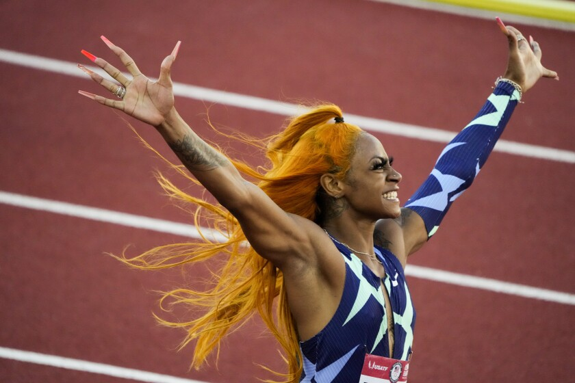 Sha'Carri Richardson celebrates after winning the women's 100-meter run at the U.S. Olympic track and field trials