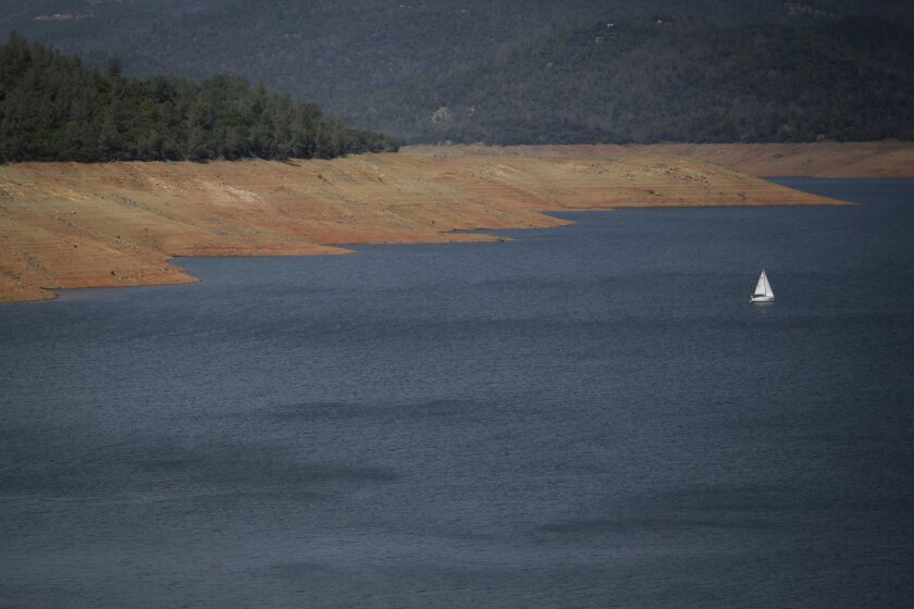In this May 2, 2014 photo, a boat sails across the Lake Oroville near Oroville, Calif. The reservoir, a water source for many farmers in the region, holds less water than it should around this time of the year. (AP Photo/Jae C. Hong)