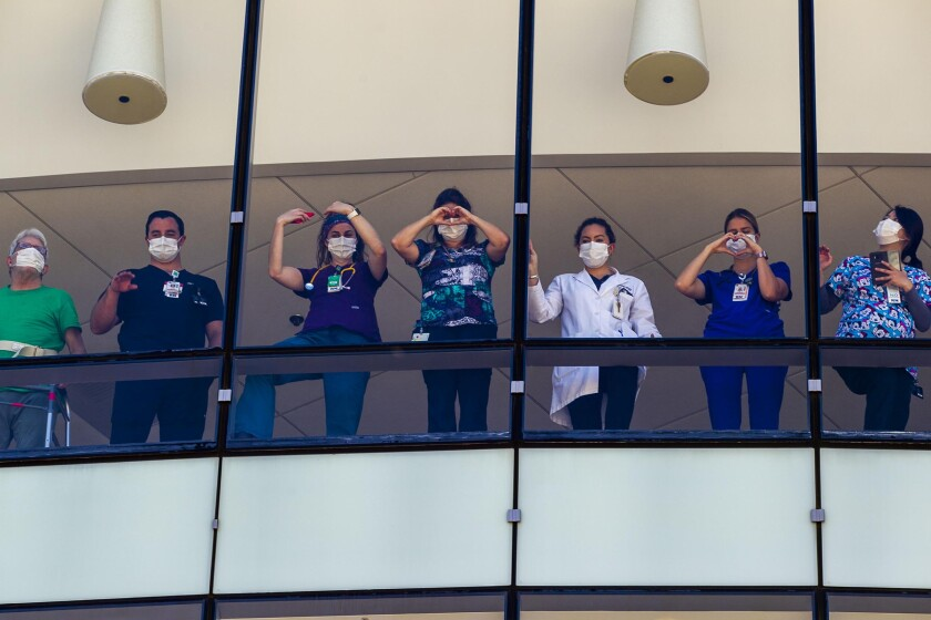 Sharp Memorial Hospital workers and patients watch a flyover salute in San Diego.