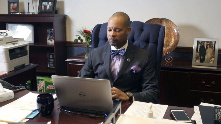 Aaron Ford, who will take office as Nevada's attorney general next month, plans to work with the FBI to enforce a gun background check law.