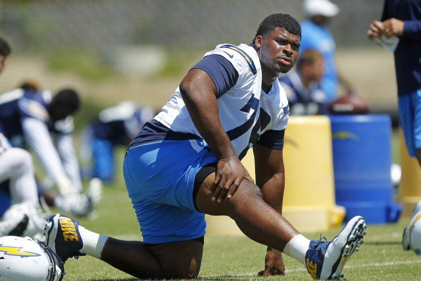 Chargers D.J. Fluker stretches during practice.