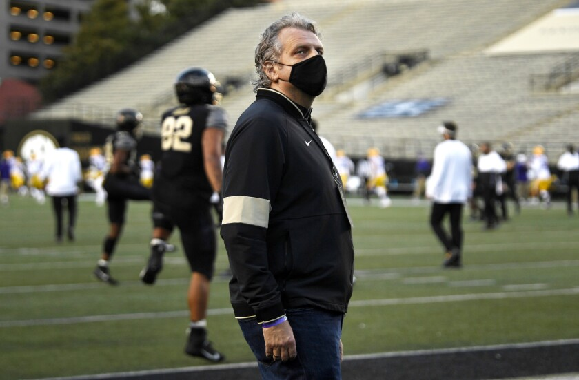Vanderbilt University chancellor Daniel Diermeier looks up at the stands before an NCAA college football game against LSU at Vanderbilt Stadium in Nashville, Saturday, Oct. 3, 2020. Vanderbilt is looking for a new football coach, and the new chancellor and athletic director want to make clear that man will have a say in how the university improves their facilities. (George Walker IV/The Tennessean via AP)