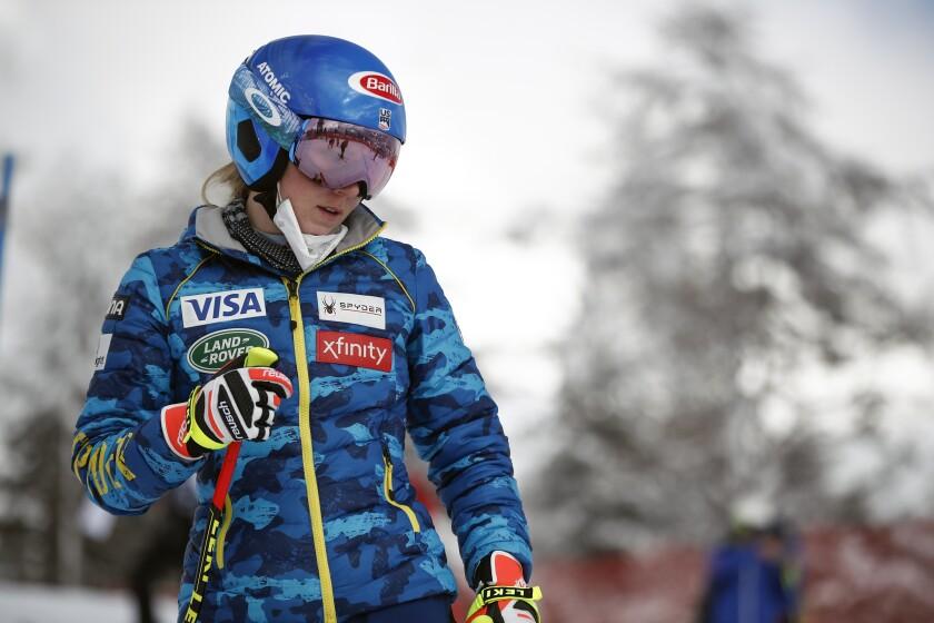 United States' Mikaela Shiffrin inspects the course prior to the women's super-G, at the alpine ski World Championships in Cortina d'Ampezzo, Italy, Tuesday, Feb. 9, 2021. (AP Photo/Gabriele Facciotti)