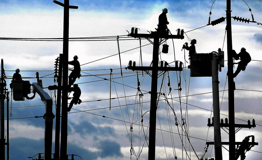 PG&E employees work on power lines.