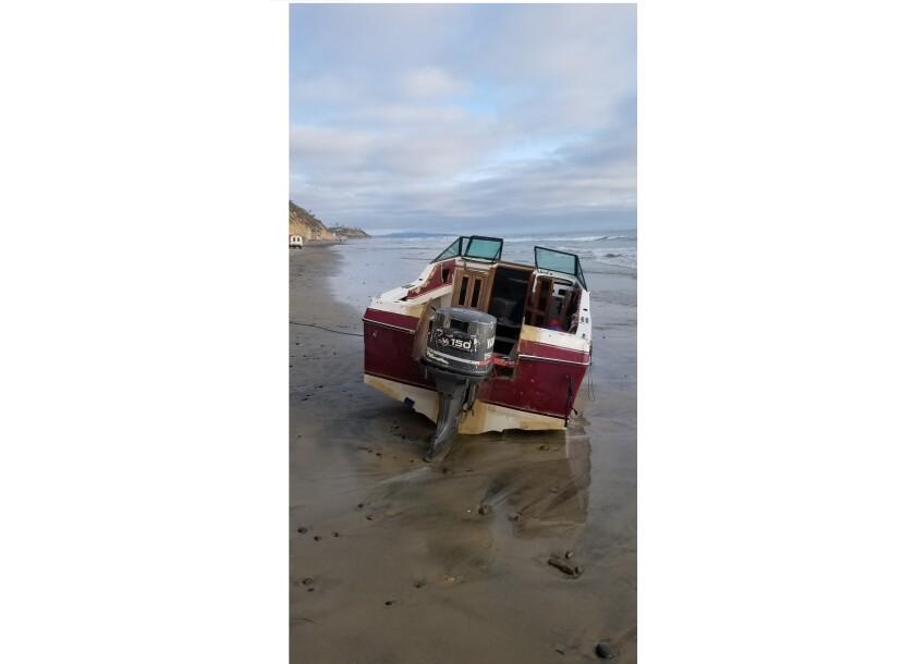 Empty boat sits on Beacon's Beach