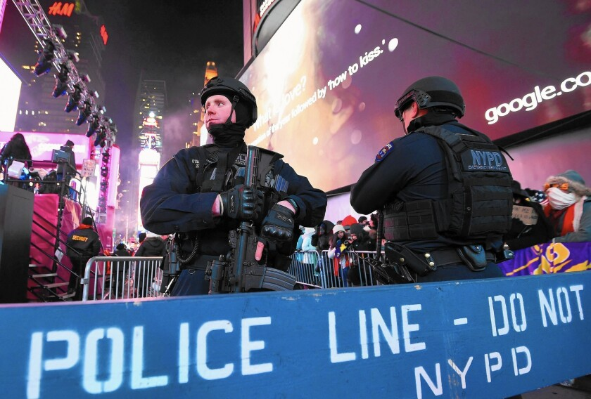 Police officers stand guard over the many revelers in New York last year.