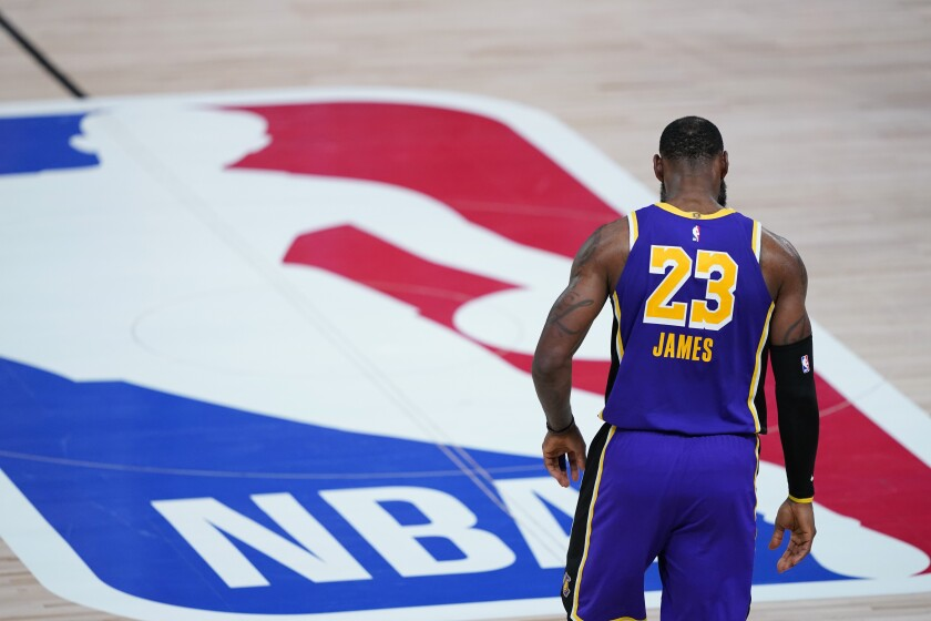 Lakers star LeBron James (23) walks across the court during a playoff game against Portland.