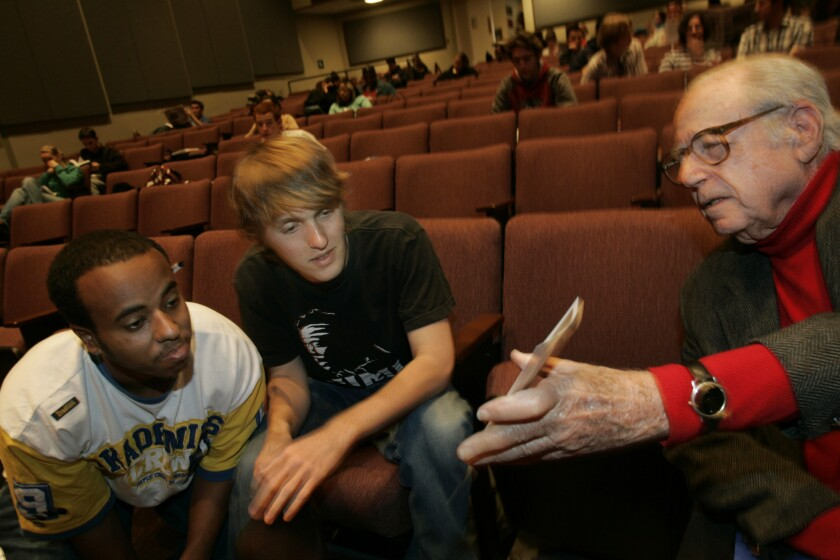 Stanley Rubin (1917-2014) -- UCLA students Elias Male, left, and Marshall Knight talk with Rubin, a prolific TV and movie writer-producer.