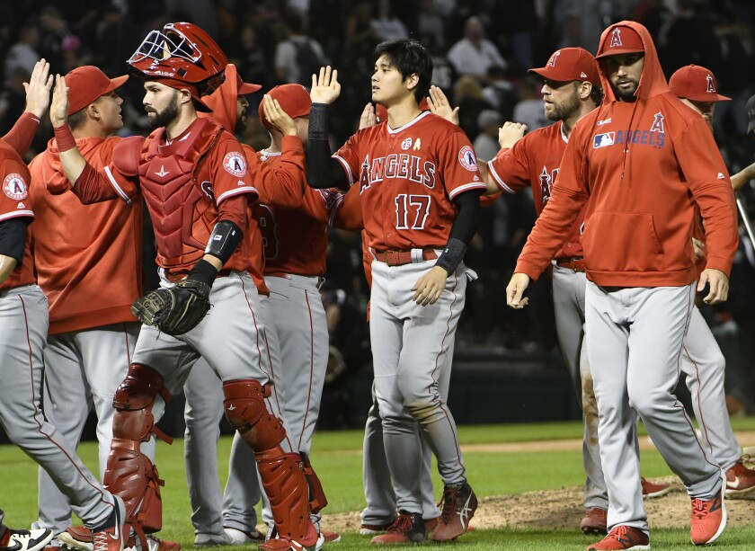 Shohei Ohtani (17) celebrates with teammates after the Angels' 8-7 win against the White Sox on Sept. 7, 2019.