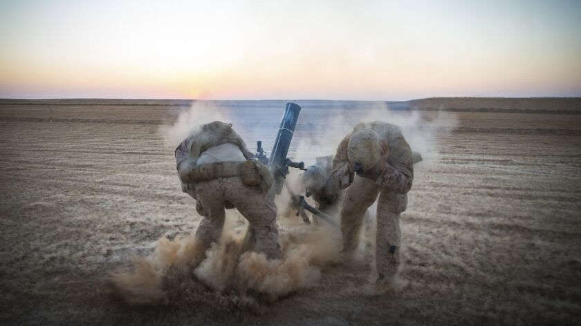 Marines with Weapons Company, 3rd Battalion, 7th Marine Regiment, fire mortars from an undisclosed location in Syria.