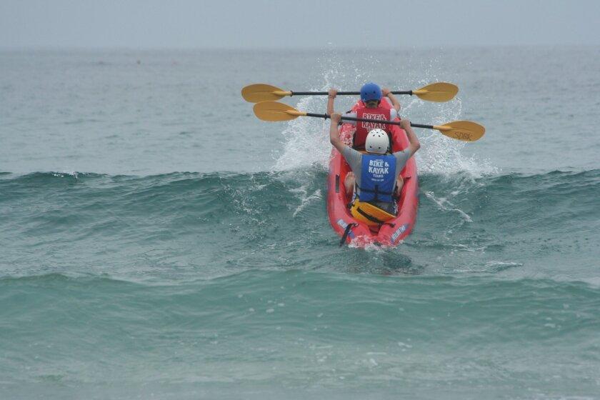 Kayakers make their way out at La Jolla Shores.  Light File Photo