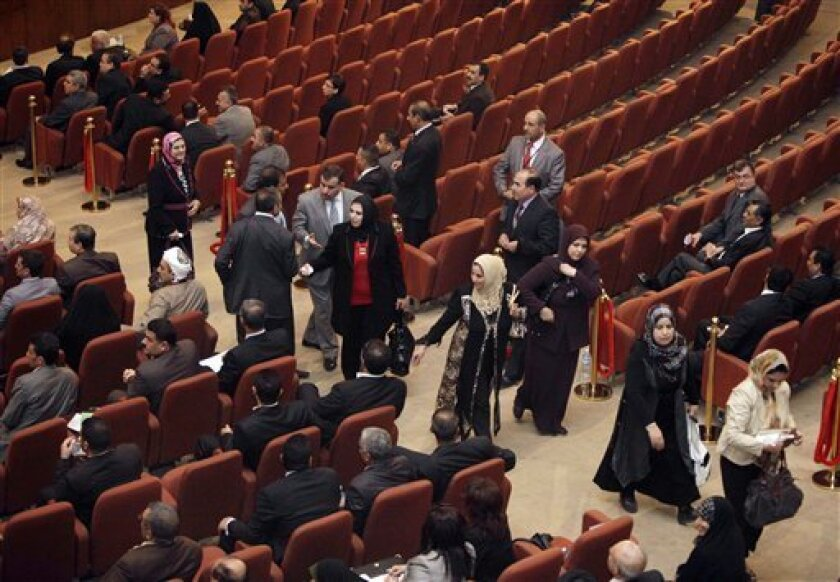 Members of his Sunni-backed coalition are seen as they walk out of of Iraq's parliament session in a protest before a vote on the presidency in Baghdad, Iraq, Thursday, Nov. 11, 2010. (AP Photo/Karim Kadim)