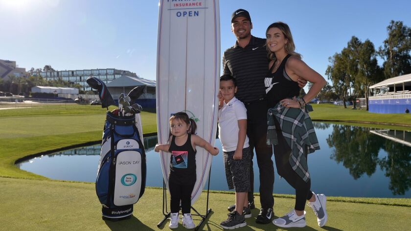 Jason Day, 30, with his wife, Ellie, son, Dash, and daughter, Lucy, poses on the 18th green of Torrey Pines South after he won the 2018 Farmers Insurance Open on Jan. 29.