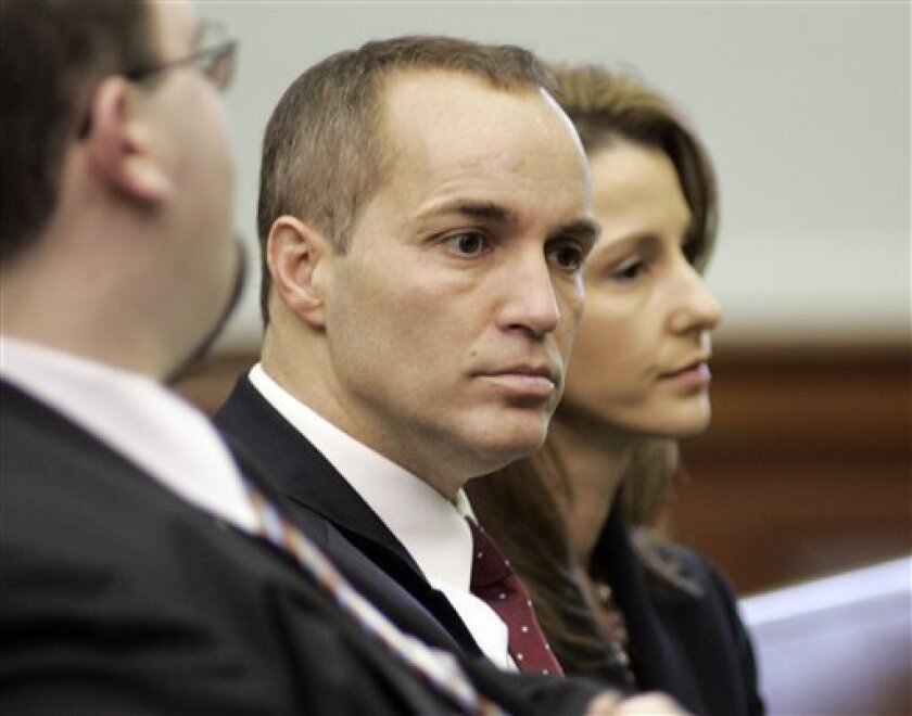 """Former aide to John Edwards Andrew Young, left, and his wife Cheri Young wait for a court hearing to began over a """"private"""" videotape authored by the candidate's mistress, at the Chatham County in Pittsboro, N.C., Friday, Feb. 5, 2010 (AP Photo/Jim R. Bounds)"""