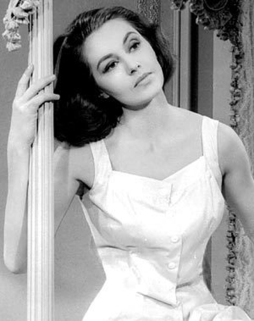 "Cyd Charisse as Ninotchka in ""Silk Stockings,"" released in 1957."