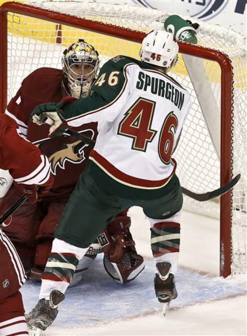 Minnesota Wild's Jared Spurgeon (46) scores on Phoenix Coyotes goaltender Mike Smith, left, during the second period in an NHL hockey game, Thursday, Feb. 28, 2013, in Glendale, Ariz. (AP Photo/Ross D. Franklin)