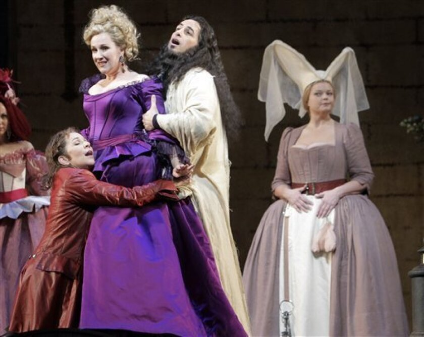 "In this March 21, 2011 photo, Diana Damrau, left, as Countess Adele, Juan Diego Florez, center, as Count Ory, and Susanne Resmark as Ragonde are shown during the final dress rehearsal of Rossini's ""Le Comte Ory"" at the Metropolitan Opera in New York's Lincoln Center. (AP Photo/Richard Drew)"
