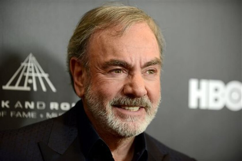 "This Thirsday, April 18, 2013 photo shows Neil Diamond at the Rock and Roll Hall of Fame Induction Ceremony at the Nokia Theatre in Los Angeles. Diamond said he's happy his ""Sweet Caroline,"" a staple of Boston Red Sox games, can provide comfort after the Boston Marathon bombing. ""There is a lot of comfort that music can offer,"" Diamond told The Associated Press. ""In this particular situation, I'd much rather it not have happened than for `Sweet Caroline' to become part of it. But it's obviously"