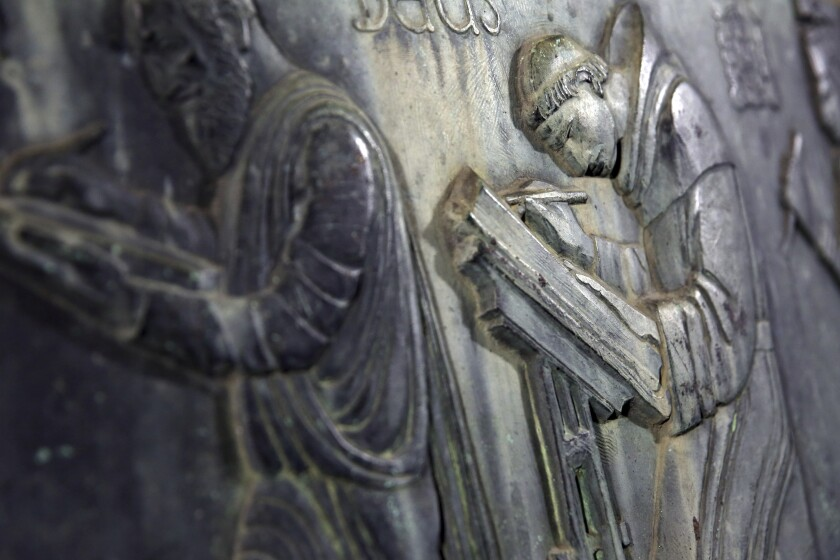 "A detail of a bronze sculpture titled ""Well of the Scribes,"" is seen during an unveiling of the long-lost sculpture after been discovered in Arizona, on Friday, Oct. 4, 2019 at the Central Library in Los Angeles. The sculpture depicting writers from different cultures vanished in 1969 when the library underwent a renovation. The story of its disappearance was revived in last year's bestselling novel ""The Library Book,"" which inspired a magazine editor to investigate its whereabouts. (Dania Maxwell/Los Angeles Times via AP)"