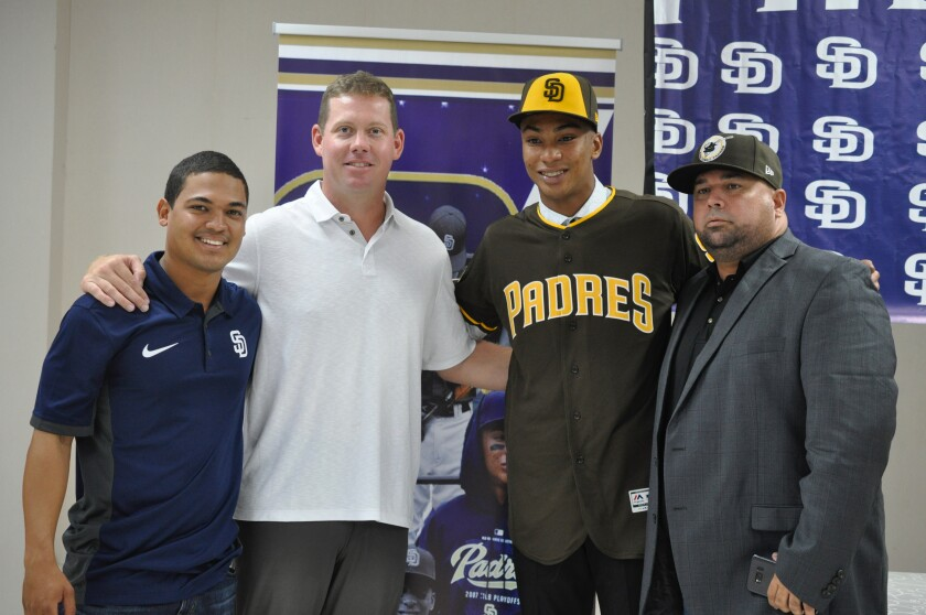 Shortstop Reginald Preciado of Panama center, signed with the Padres on July 2, 2019. He is pictured with, from left to right, Dominican coordinator Alvin Duran, international scouting director Chris Kemp and Panama area scout Ricardo Montenegro.