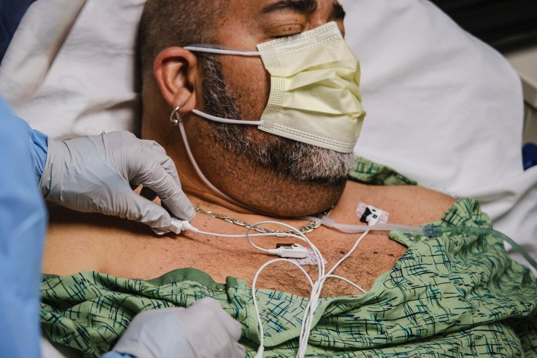 Nurse checks patient's vital signs