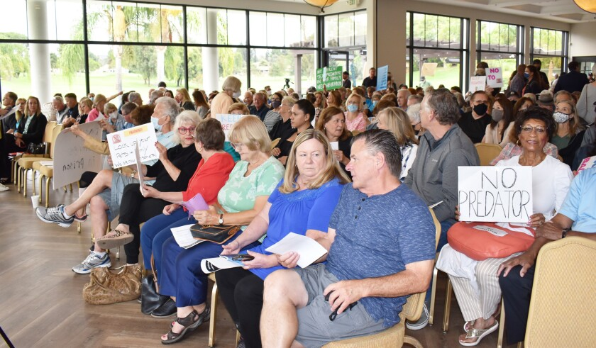 Hundreds of community members gathered at the Country Club of Rancho Bernardo for a meeting opposing Douglas Badger.