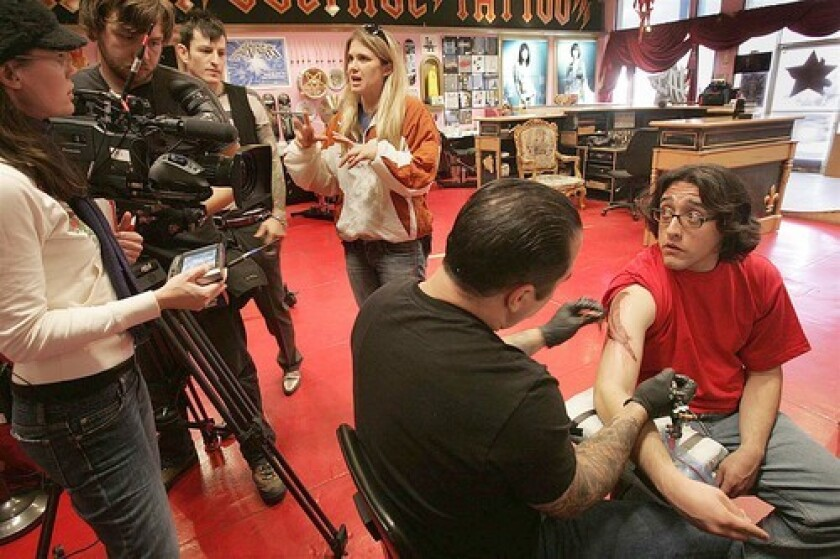 "Joshua Sandoval gets inked by Corey Miller at High Voltage Tattoo during taping for the show ""LA Ink."" Sandoval envisioned a tattoo that would speak to his place in the world."