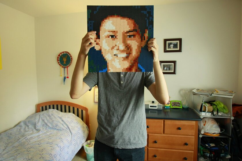 Eric Chen with a Lego portrait of himself.