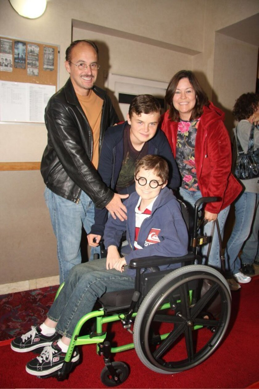 Among the guests at the premiere are the Contreras family — dad Mark, mom Dana, and sons Nicolas and Matthew (seated.)
