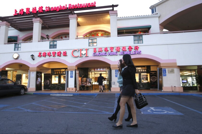 Shoppers walk through the San Gabriel Square in San Gabriel, where tourism from China is transforming the area.