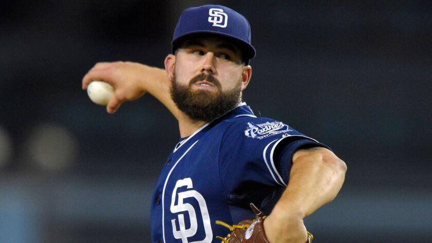 Padres starting pitcher Casey Kelly throws to the plate during the first inning of a baseball game against the Los Angeles Dodgers, Friday, Oct. 2, 2015, in Los Angeles.