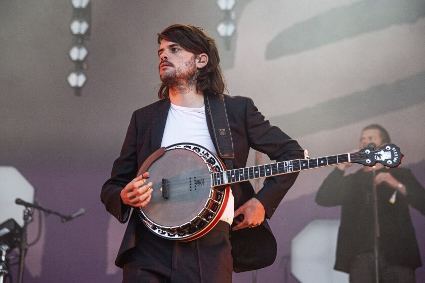 """FILE - In this Sunday, May 26, 2019 file photo, Winston Marshall of Mumford & Sons performs at the BottleRock Napa Valley Music Festival at Napa Valley Expo, in Napa, Calif. Marshall says he is leaving folk-rock group Mumford & Sons so that he can """"speak freely"""" about political issues. Marshall took a break from the band in March after sparking a social media storm by tweeting admiration for a book by right-wing writer-activist Andy Ngo. Marshall was accused online of endorsing the far right, but said Thursday, June 24, 2021 that """"nothing could be further from the truth.""""( Photo by Amy Harris/Invision/AP, File)"""