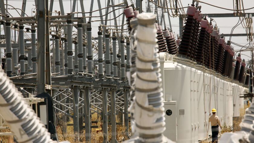 NORTH RIDGE, JULY 9, 2017 -- A Department of Water and Power employee checks on transformers the day