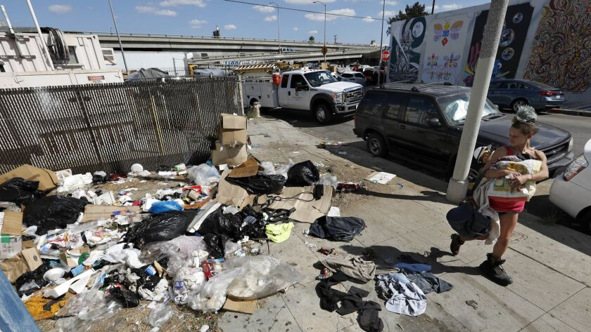 A pile of trash sits uncollected on Santee Street between 18th Street and Washington Boulevard in the Fashion District of Los Angeles on Oct. 11, 2018.