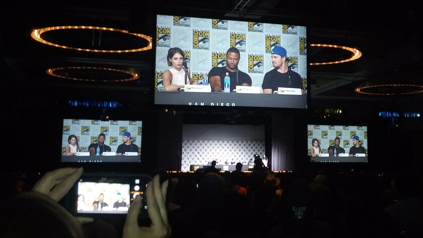 "At the ""Arrow"" panel at Comic-Con, Willa Holland, David Ramsey and Stephen Amell talk to the crowd."