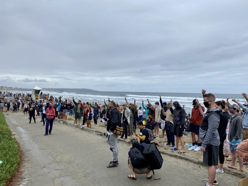 Hundreds of people attended the June 6 Paddle for Peace at Tourmaline Surfing Park to honor George Floyd.