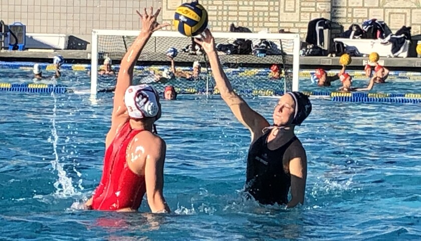 Newport Harbor's Taylor Smith shoots a lob shot against Orange Lutheran's Izzy Gazzaniga in the fourth quarter of Friday's Santa Barbara Tournament of Champions quarterfinal match at Dos Pueblos High in Goleta.