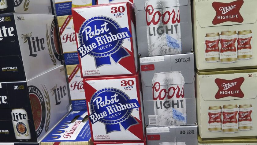 In this photo taken on Thursday, Nov. 8, 2018, cases of Pabst Blue Ribbon and Coors Light are stacke