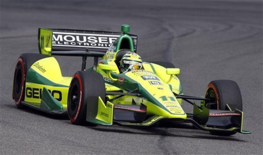 Tony Kanaan, of Brazil,  races during qualifying for the Grand Prix of Alabama IndyCar auto race at Barber Motorsports Park on Saturday, March 31, 2012, in Birmingham, Ala. (AP Photo/Butch Dill)