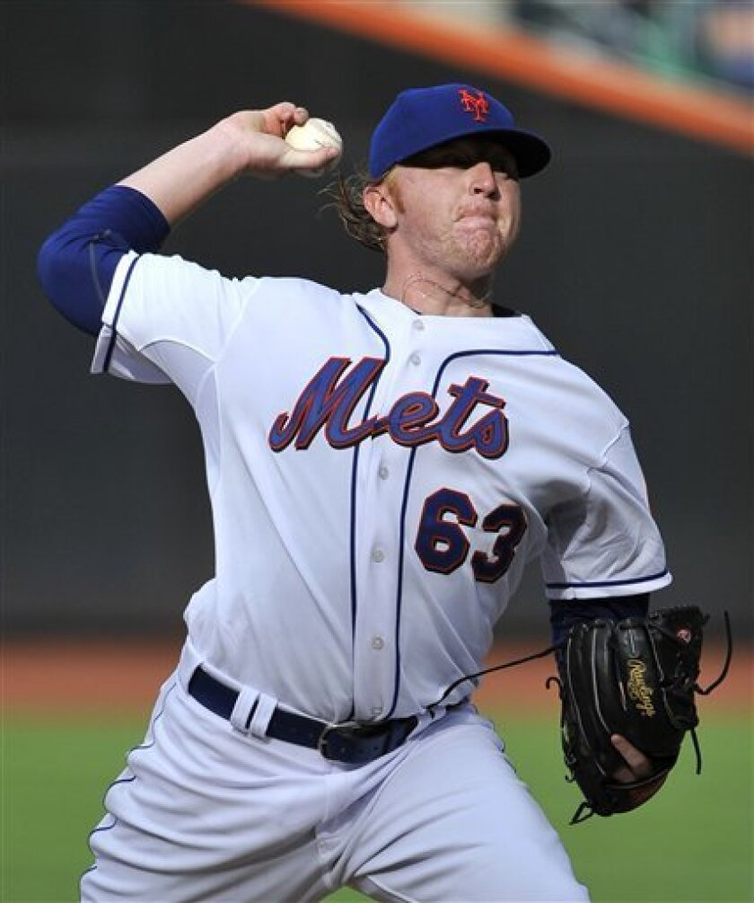 New York Mets' Chris Schwinden throws against the Atlanta Braves in the first inning of the first game of a baseball doubleheader on Thursday, Sept. 8, 2011, at Citi Field in New York. (AP Photo/Kathy Kmonicek)