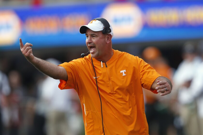 Tennessee head coach Jeremy Pruitt yells to his players during a game against Georgia on Sept. 29, 2018 in Athens, Ga.
