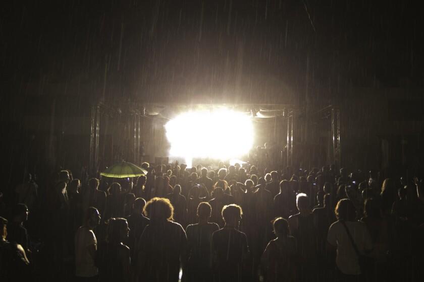 Nicolas Jaar begins his set as rain begins to fall on the crowd at the Manana Cuba festival.