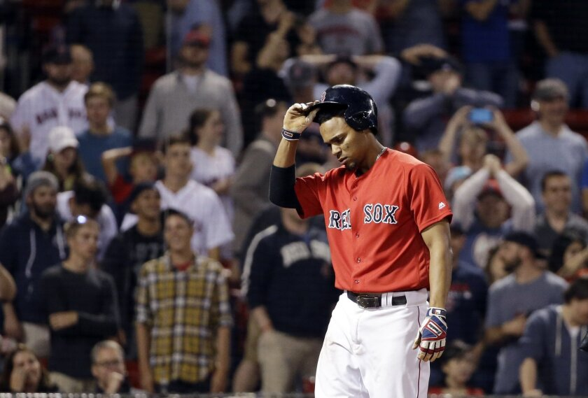 Boston Red Sox's Xander Bogaerts reacts after striking out in the ninth inning to end  a baseball game against the Toronto Blue Jays, Friday, June 3, 2016, in Boston. The Blue Jays stopped Bogaerts' 26-game hitting streak while winning 5-2 Friday night. (AP Photo/Elise Amendola)